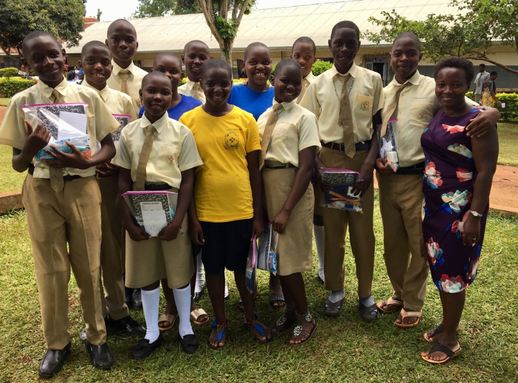Current secondary students recieve blessing bags from a visiting mission team.